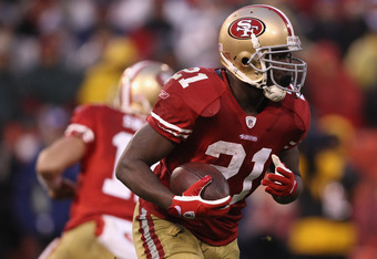 SAN FRANCISCO, CA - JANUARY 22:  Frank Gore #21 of the San Francisco 49ers runs the ball during the NFC Championship Game against the New York Giants at Candlestick Park on January 22, 2012 in San Francisco, California.  (Photo by Ezra Shaw/Getty Images)