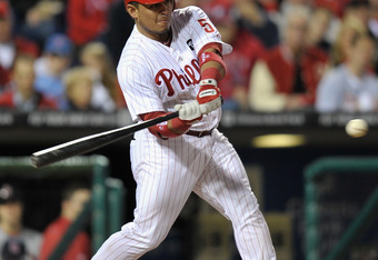 PHILADELPHIA, PA - OCTOBER 07:  Carlos Ruiz #51 of the Philadelphia Phillies bats against the St. Louis Cardinals during Game Five of the National League Divisional Series at Citizens Bank Park on October 7, 2011 in Philadelphia, Pennsylvania.  (Photo by