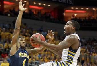 LOUISVILLE, KY - MARCH 17:  Darius Johnson-Odom #1 of the Marquette Golden Eagles goes up for a shot against Latreze Mushatt #4 of the Murray State Racers in the first half during the third round of the 2012 NCAA Men's Basketball Tournament at KFC YUM! Ce