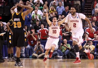 PORTLAND, OR - MARCH 17:  Will Sheehey #10 and Christian Watford #2 of the Indiana Hoosiers celebrate along with their teammates after the Hoosiers as Bradford Burgess #20 of the Virginia Commonwealth Rams is dejected after the Hoosiers 63-61 during the t