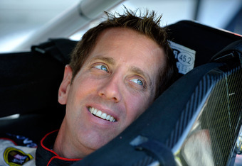 BRISTOL, TN - MARCH 17:  Greg Biffle, driver of the #16 3M/811 Ford, sits in his car in the garage area during practice for the NASCAR Sprint Cup Series Food City 500 at Bristol Motor Speedway on March 17, 2012 in Bristol, Tennessee.  (Photo by Rainier Eh