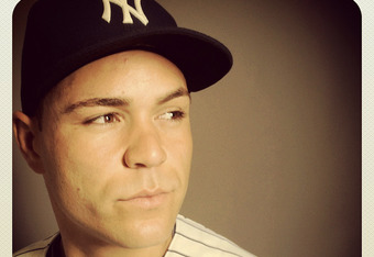 TAMPA, FL - FEBRUARY 27: (EDITOR'S NOTE: Image was shot with an iPhone using Instagram) Russell Martin #55 of the New York Yankees poses for a portrait during the New York Yankees Photo Day on February 27, 2012 in Tampa, Florida.  (Photo by Nick Laham/Get