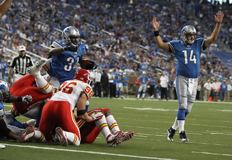 DETROIT, MI - SEPTEMBER 18:  Keiland Williams #34 of the Detroit Lions and teammate Shaun Hill #14 celebrate a touchdown in front of Andy Studebaker #96 of the Kansas City Chiefs during a NFL game at Ford Field on September 18, 2011 in Detroit, Michigan.