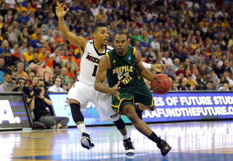 OMAHA, NE - MARCH 16:  Brandon Wheeless #24 of the Norfolk State Spartans drives against Phil Pressey #1 of the Missouri Tigers during the second round of the 2012 NCAA Men's Basketball Tournament at CenturyLink Center on March 16, 2012 in Omaha, Nebraska