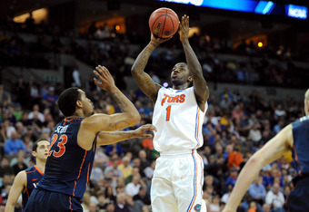 OMAHA, NE - MARCH 16:  Kenny Boynton #1 of the Florida Gators attempts a shot in the first half against Mike Scott #23 of the Virginia Cavaliers during the second round of the 2012 NCAA Men's Basketball Tournament at CenturyLink Center on March 16, 2012 i