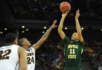 OMAHA, NE - MARCH 16:  Pendarvis Williams #11 of the Norfolk State Spartans attempts a shot in the first half  against Kim English #24 of the Missouri Tigers during the second round of the 2012 NCAA Men's Basketball Tournament at CenturyLink Center on Mar