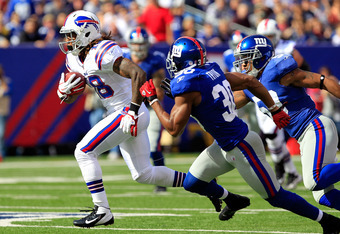 EAST RUTHERFORD, NJ - OCTOBER 16:  Naaman Roosevelt #18 of the Buffalo Bills runs for a touchdown against Justin Tryon #30 of the New York Giants at MetLife Stadium on October 16, 2011 in East Rutherford, New Jersey.  (Photo by Chris Trotman/Getty Images)