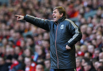 LIVERPOOL, ENGLAND - MARCH 18:  Kenny Dalglish, manager of Liverpool shouts instructions during the FA Cup with Budweiser Sixth Round match between Liverpool and Stoke City at Anfield on March 18, 2012 in Liverpool, England.  (Photo by Alex Livesey/Getty