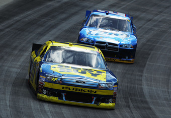 BRISTOL, TN - MARCH 18:  Matt Kenseth, driver of the #17 Best Buy Ford, leads Brad Keselowski, driver of the #2 Miller Lite Dodge, during the NASCAR Sprint Cup Series Food City 500 at Bristol Motor Speedway on March 18, 2012 in Bristol, Tennessee.  (Photo