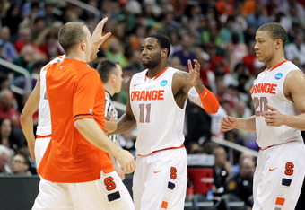 PITTSBURGH, PA - MARCH 17:  Scoop Jardine #11 and Brandon Triche #20 of the Syracuse Orange celebrate a play with teammates against the Kansas State Wildcats during the third round of the 2012 NCAA Men's Basketball Tournament at Consol Energy Center on Ma