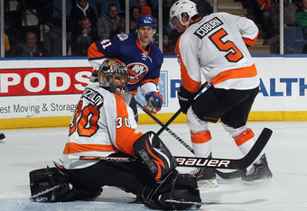 UNIONDALE, NY - MARCH 15:  Ilya Bryzgalov #30 of the Philadelphia Flyers tends net against the New York Islanders during the second period at the Nassau Veterans Memorial Coliseum on March 15, 2012 in Uniondale, New York.  (Photo by Bruce Bennett/Getty Im