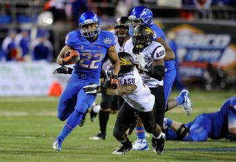 LAS VEGAS, NV - DECEMBER 22:  Doug Martin #22 of the Boise State Broncos runs for yardage ahaead of Keelan Johnson #10 of the Arizona State Sun Devils during the MAACO Bowl Las Vegas at Sam Boyd Stadium December 22, 2011 in Las Vegas, Nevada. Boise State