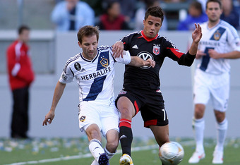 CARSON, CA - MARCH 18:  Mike Magee #18 of the Los Angeles Galaxy and Marcelo Saragosa #11 of D.C. United vie for the ball in the first half during the MLS match at The Home Depot Center on March 18, 2012 in Carson, California. The Galaxy defeated United 3