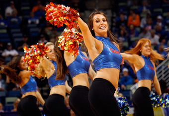 NEW ORLEANS, LA - MARCH 09:  Cheerleaders for the Florida Gators perform against the Alabama Crimson Tide during their quarterfinal game in the 2012 SEC Men's Basketball Conference Tournament at New Orleans Arena on March 9, 2012 in New Orleans, Louisiana