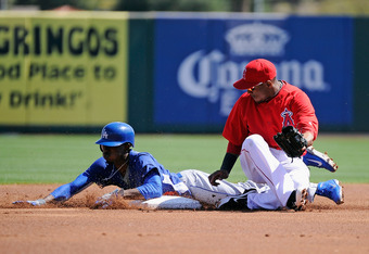 TEMPE, AZ - MARCH 12:  Dee Gordon #9 of the Los Angeles Dodgers steals second base before the tag by Erick Aybar #2 of the Los Angeles Angels of Anaheim in the first inning of a spring training baseball game at Tempe Diablo Stadium on March 12, 2012 in Te