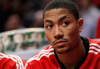 CHICAGO, IL - MAY 18:  Derrick Rose #1 of the Chicago Bulls looks on from the bench against the Chicago Bulls in Game Two of the Eastern Conference Finals during the 2011 NBA Playoffs on May 18, 2011 at the United Center in Chicago, Illinois. The Heat won