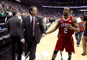 COLUMBUS, OH - MARCH 18:  Head coach Mark Gottfried of the North Carolina State Wolfpack walks off the court with Lorenzo Brown #2 after defeating the Georgetown Hoyas during the third round of the 2012 NCAA Men's basketball tournament at Nationwide Arena
