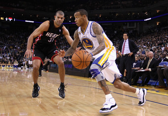 OAKLAND, CA - JANUARY 10:  Monta Ellis #8 of the Golden State Warriors drives on Shane Battier #31 of the Miami Heat at Oracle Arena on January 10, 2012 in Oakland, California.  NOTE TO USER: User expressly acknowledges and agrees that, by downloading and