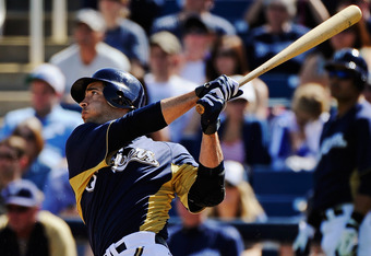 PHOENIX, AZ - MARCH 08:  Ryan Braun #8 of the Milwaukee Brewers hits a two-run home run during the third inning of a spring training baseball game against the Cincinnati Reds at Maryvale Baseball Park on March 8, 2012 in Phoenix, Arizona.  (Photo by Kevor