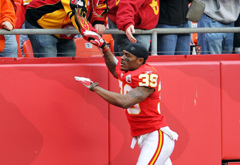 KANSAS CITY, MO - DECEMBER 18:  Brandon Carr #39 of the Kansas City Chiefs celebrates with fans after the Chiefs defeated the Green Bay Packers 19-14 to win the gameon December 18, 2011 at Arrowhead Stadium in Kansas City, Missouri.  (Photo by Jamie Squir