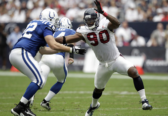HOUSTON - SEPTEMBER 11:  Mario Williams #90 of the Houston Texans battles with offensive tackle  Jeff Linkenbach #72 of the Indianapolis Colts during the season-opening game at Reliant Stadium on September 11, 2011 in Houston, Texas.  (Photo by Bob Levey/