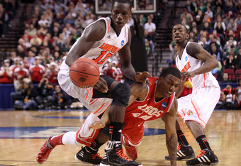 PORTLAND, OR - MARCH 17:  Gorgui Dieng #10 of the Louisville Cardinals and Demetrius Walker #40 of the New Mexico Lobos go after a loose ball in the second half during the third round of the 2012 NCAA Men's Basketball Tournament at the Rose Garden Arena o