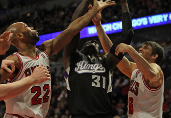 CHICAGO, IL - FEBRUARY 14: J.J. Hickson #31 of the Sacramento Kings tries to rebound between Taj Gibson #22 and Kyle Korver #26 of the Chicago Bulls at the United Center on February 14, 2012 in Chicago, Illinois. NOTE TO USER: User expressly acknowledges