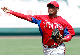 BRADENTON, FL - MARCH 16:  Shortstop Freddy Galvis #13 of the Philadelphia Phillies throws over to first for an out against the Pittsburgh Pirates during a Grapefruit League Spring Training Game at McKechnie Field on March 16, 2011 in Bradenton, Florida.