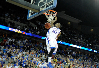 Tyshawn Taylor slams home the final basket of the game.