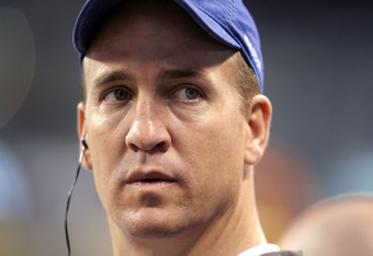 INDIANAPOLIS, IN - NOVEMBER 27: Peyton Manning of the Indianapolis Colts watches the action during the game against the Carolina Panthers at Lucas Oil Stadium on November 27, 2011 in Indianapolis, Indiana.  (Photo by Andy Lyons/Getty Images)