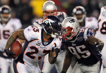 FOXBORO, MA - JANUARY 14:  Willis McGahee #23 of the Denver Broncos runs the ball against Mark Anderson #95 of the New England Patriots during their AFC Divisional Playoff Game at Gillette Stadium on January 14, 2012 in Foxboro, Massachusetts.  (Photo by