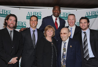 NEW YORK, NY - JANUARY 31:  (L-R) R.A Dickey, Mark Teixeira, Diana Munson, Dikembe Mutombo, Yogi Berra, Chris Mullin and Daniel Murphy attend the 32nd Annual Thurman Munson Awards at the Grand Hyatt on January 31, 2012 in New York City.  (Photo by Dimitri