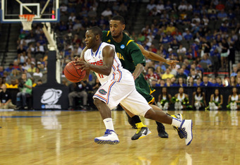 OMAHA, NE - MARCH 18:  Erving Walker #11 of the Florida Gators drives in the second half against Rodney McCauley #15 of the Norfolk State Spartans during the third round of the 2012 NCAA Men's Basketball Tournament at CenturyLink Center on March 18, 2012