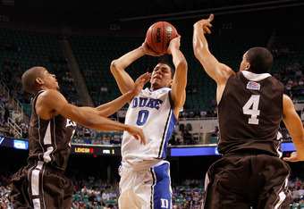 GREENSBORO, NC - MARCH 16:  Austin Rivers #0 of the Duke Blue Devils drives to the basket between C.J. McCollum #3 and John Adams #4 of the Lehigh Mountain Hawks in the first half during the second round of the 2012 NCAA Men's Basketball Tournament at Gre