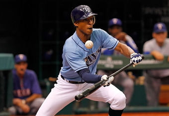ST. PETERSBURG - OCTOBER 04:  Oufielder B.J. Upton #2 of the Tampa Bay Rays attempts a bunt against the Texas Rangers during Game Four of the American League Division Series at Tropicana Field on October 4, 2011 in St. Petersburg, Florida.  (Photo by J. M