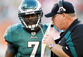 MIAMI GARDENS, FL - DECEMBER 11:  Quarterback Michael Vick #7 (L) of the Philadelphia Eagles chats with Head Coach Andy Reid (R) against the Miami Dolphins at Sun Life Stadium on December 11, 2011 in Miami Gardens, Florida.  (Photo by Marc Serota/Getty Im