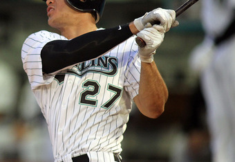 MIAMI GARDENS, FL - SEPTEMBER 19:  Mike Stanton #27 of the Florida Marlins hits a solo home run against the Atlanta Braves  at Sun Life Stadium on September 19, 2011 in Miami Gardens, Florida.  (Photo by Marc Serota/Getty Images)