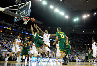OMAHA, NE - MARCH 18:  Brandon Wheeless #24 of the Norfolk State Spartans goes to the basket for a shot attempt against Patric Young #4 of the Florida Gators during the third round of the 2012 NCAA Men's Basketball Tournament at CenturyLink Center on Marc