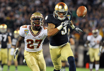ORLANDO, FL - DECEMBER 29: Wide receiver Michael Floyd #3 of the Notre Dame Fight Irish chases a long pass against the Florida State Seminoles in the Champs Sports Bowl December 29, 2011 at the Florida Citrus Bowl in Orlando, Florida.  FSU won 21 - 7. (Ph