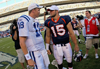 DENVER - SEPTEMBER 26:  Quarterback Peyton Manning #18 of the Indianapolis Colts and quarterback Tim Tebow #15 of the Denver Broncos meet at midfield after the game at INVESCO Field at Mile High on September 26, 2010 in Denver, Colorado. The Colts defeate
