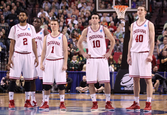PORTLAND, OR - MARCH 17:  (C) Will Sheehey #10 of the Indiana Hoosiers stands with teammates Christian Watford #2, Victor Oladipo #4, Jordan Hulls #1 and Cody Zeller #40 after Sheehey was called for a flagrant foul in the first half against the Virginia C