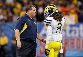 NEW ORLEANS, LA - JANUARY 03:  Head coach Brady Hoke of the Michigan Wolverines talks with J.T. Floyd #8 against the Virginia Tech Hokies during the Allstate Sugar Bowl at Mercedes-Benz Superdome on January 3, 2012 in New Orleans, Louisiana.  (Photo by Ke