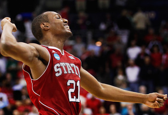 COLUMBUS, OH - MARCH 18:  C.J. Williams #21 of the North Carolina State Wolfpack celebrates after the Wolfpack defeated the Georgetown Hoyas  during the third round of the 2012 NCAA Men's Basketball Tournament at Nationwide Arena on March 18, 2012 in Colu