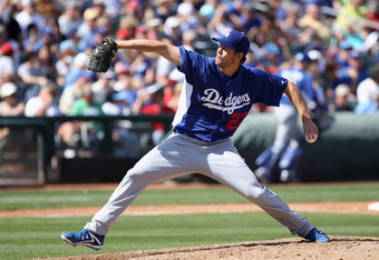 SURPRISE, AZ - MARCH 09:  Starting pitcher Clayton Kershaw #22 of the Los Angeles Dodgers pitches against the Texas Rangers during the spring training game at Surprise Stadium on March 9, 2012 in Surprise, Arizona.  (Photo by Christian Petersen/Getty Imag