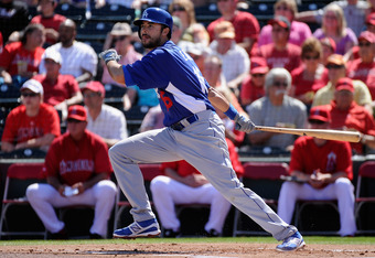 TEMPE, AZ - MARCH 12:  Andre Ethier #16 of the Los Angeles Dodgers hits a one run double to score Dee Gordon # 9 in the first inning of a spring training baseball game against Los Angeles Angels of Anaheim at Tempe Diablo Stadium on March 12, 2012 in Temp