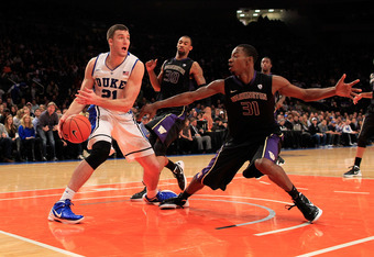 NEW YORK, NY - DECEMBER 10: Miles Plumlee #21 of the Duke Blue Devils controls the ball from Terrence Ross #31 of the Washington Huskies at Madison Square Garden on December 10, 2011 in New York City.  (Photo by Chris Trotman/Getty Images)