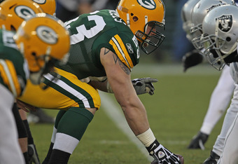 GREEN BAY, WI - DECEMBER 11: Scott Wells #63 of the Green Bay Packers prepares to snap the ball against the Oakland Raiders at Lambeau Field on December 11, 2011 in Green Bay, Wisconsin. The Packers defeated the Raiders 46-16. (Photo by Jonathan Daniel/Ge