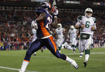 DENVER, CO - NOVEMBER 17:  Cornerback Andre' Goodman #21 of the Denver Broncos celebrates as he returns an interception of a pass by quarterback Mark Sanchez #6 of the New York Jets 26 yards for a third quarter touchdown at Sports Authority Field at Mile