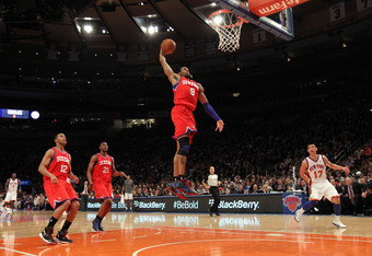 NEW YORK, NY - MARCH 11: Andre Iguodala #9 of the Philadelphia 76ers dunks the ball against the New York Knicks at Madison Square Garden on March 11, 2012 in New York City. NOTE TO USER: User expressly acknowledges and agrees that, by downloading and or u