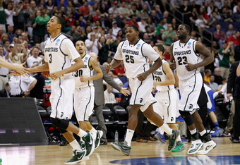 COLUMBUS, OH - MARCH 18: Brandan Kearney #3, Brandon Wood #30, Derrick Nix #25, Travis Trice #20 and Draymond Green #23 of the Michigan State Spartans run to the bench for a timeout against the Saint Louis Billikens during the third round of the 2012 NCAA